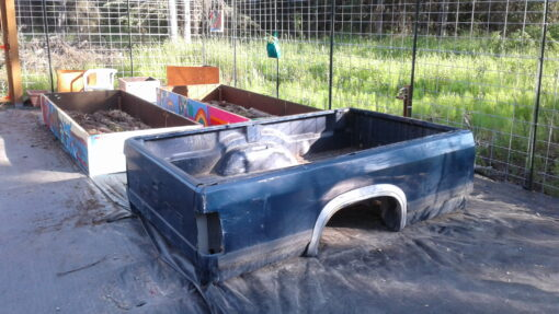 Free Pickup Truck Bed. Notice the garage panel beds in background with logs to fill bed using hugelkulter method.